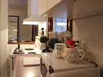 Kitchen with microwave, stove, oven, fridge, dishwasher, toaster, coffee machine & grinder, kettle