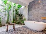 First bedroom's en-suite semi-outdoor bathroom