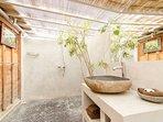 Semi-outdoor bathroom with sunlight