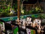 Wooden Villa dining table at night