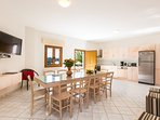 Spacious main open plan living, dining area and fully equipped kitchen
