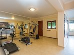 Gym area with a collection of fitness equipment