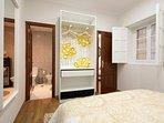 Bedroom with an open wardrobe and en-suite bathroom.