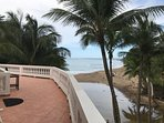 Upstairs deck facing sandy beach