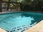 Pool overlooking sandy beach