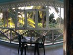 Vista giardino, balcone con zanzariera.