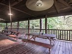 1100 square foot covered deck with three picnic tables.