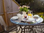 Outdoor table for 4 on the private decking. Perfect for breakfast or an summer's evening BBQ.