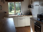 Another view of the kitchen with electric stove and oven