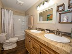 tiled double sink vanity and full tub