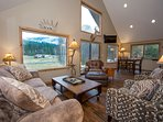 comfortable living room with wrap around windows with killer views  sliding door to patio