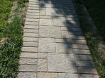 Interlock pathway to the house from the parking area allows comfortable rolling of wheeled bags