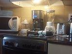 Microwave, blender, coffee maker, toaster, kettle, small utensils, cookware