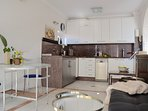 The roomy, light and open living-room/ kitchen