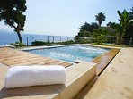 The 4,5 meter long jacuzzi/hot tub with panoramic sea view and space for up to 10 people