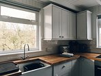 The kitchen is well-equipped with an electric oven, hob, fridge freezer, kettle, toaster and blender