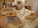 Comfortable sofas and chair in the spacious lounge with wonderful pool view. FreeSat TV & DVD/CD