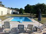Le Manoir - the 10 x 5m pool with diving board set in huge grounds with beautiful trees.