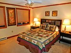 Large master bedroom with en-suite full bathroom faces Shavers Lake and mountains.