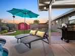 Back yard with chaise lounges, BBQ and umbrella!