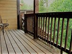 The other view of the deck, leading you to the apartment surrounded by trees and wildlife.