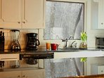 Kitchen with granite countertops and everything you need to make a feast