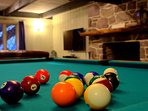 Play A Game Of Pool By The Fireplace While Watching The Game