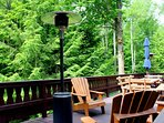 The large deck, Adirondack chairs and heater overlooking Lake Naomis green belt