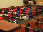 The Foosball table in the game room