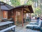 Back deck, gas grill and plenty of seating to enjoy the sounds of the seasonal stream