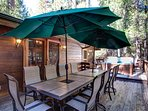 Back deck with umbrella picnic tables and hot tub
