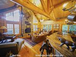 Red Stag Lodge's main floor evokes the warmth and coziness of the true cabin lifestyle, featuring a soaring real stone...