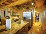 The gourmet kitchen contains all stainless steel appliances, rainforest granite countertops, and high-end cookware.