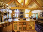 Enjoy the view out the living room windows while cooking in the kitchen at Red Stag Lodge.