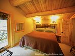 Guests will enjoy this king side bed at Red Stag Lodge.