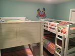 Kids bunk bed room with shared hall full bath