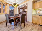 Large round dining table with seating for 4-6 guests, wet bar, and custom hutch, includes amazing views!