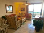 Living room facing the patio & pool/ocean   Cable TV w/ 200+ premium channels & great WIFI