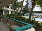 View of the pool from private stairs. Gray box is full of snorkel gear and pool/beach toys