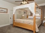 Bed Room with queen size four post canopy bed.