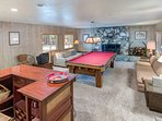Game room with full size pool table, stone fireplace, bar