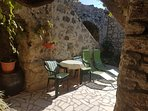 The yard of the Cave where you can enjoy shade most of the day during Summer months and sunbathing