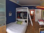 Kid's room with double bed on floor and single bunk bed