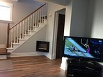 Relax and unwind in the main living area with cable TV, large flat TV and a cozy electric fireplace.
