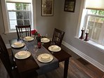 Enjoy food and laughter in the formal dining room.