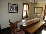 Farm-style dining table can sit comfortably up to 8 guests.