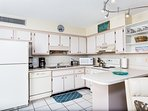 Full kitchen has all you need for cooking a feast or mixing refreshments.