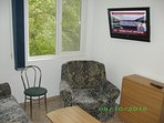 Living room with TV on wall