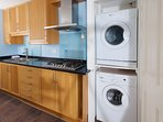 we have a washer and a dryer in the cupboard in the kitchen