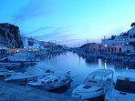 Ciutadella harbour at Dusk - surrounded by meat and fish resaturants and bars plus a few discos.